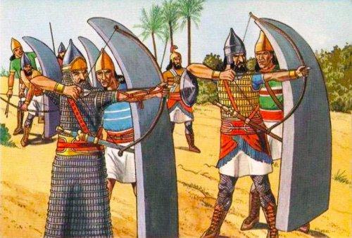 Arqueiros assírios sendo protegidos por escudos